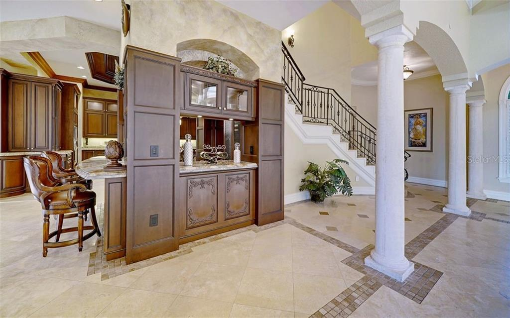 Stairs, butler's pantry, wine bar - Single Family Home for sale at 8257 Archers Ct, Sarasota, FL 34240 - MLS Number is N6109007