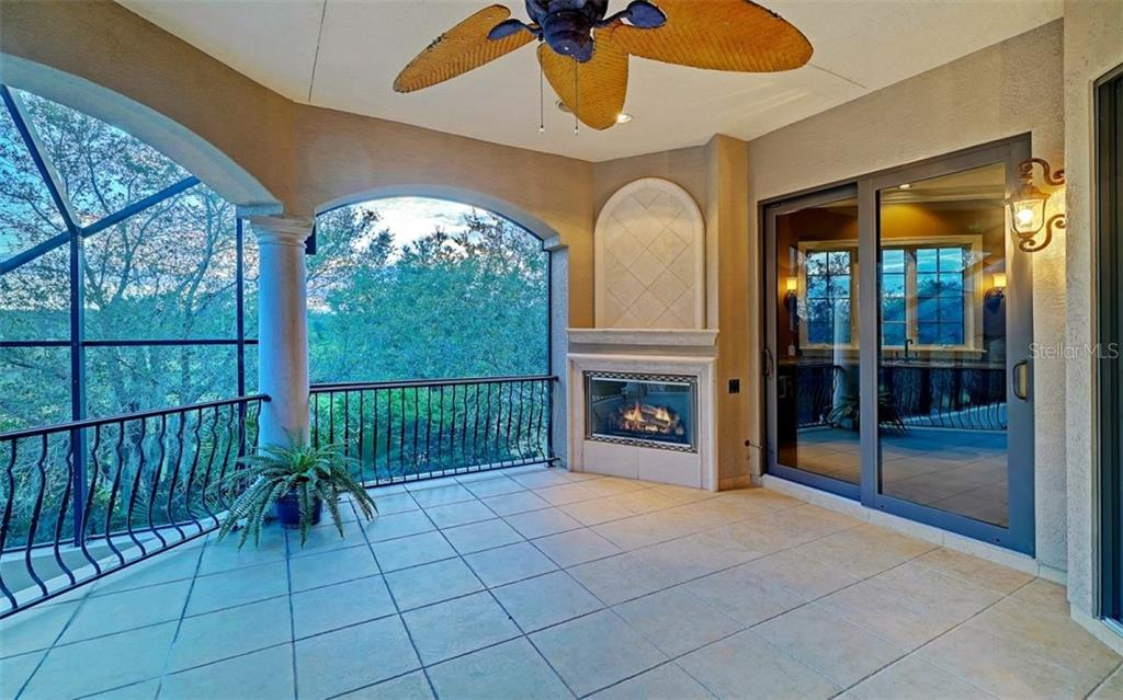 Upper balcony with gas fireplace - Single Family Home for sale at 8257 Archers Ct, Sarasota, FL 34240 - MLS Number is N6109007