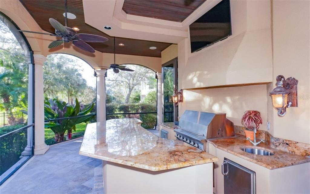Outdoor kitchen by the pool - Single Family Home for sale at 8257 Archers Ct, Sarasota, FL 34240 - MLS Number is N6109007