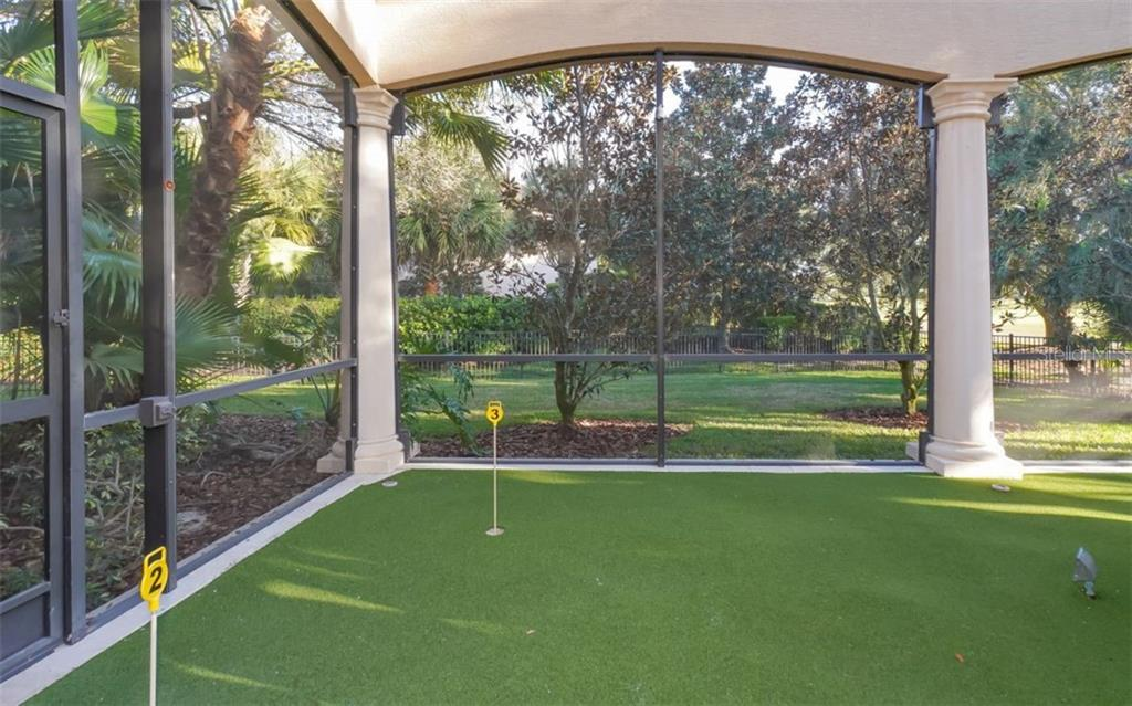 Putting green within the screened lanai - Single Family Home for sale at 8257 Archers Ct, Sarasota, FL 34240 - MLS Number is N6109007
