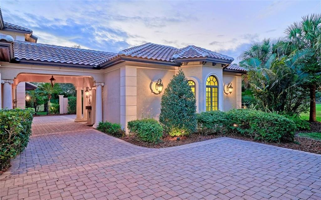 Portico and 4 car garage - Single Family Home for sale at 8257 Archers Ct, Sarasota, FL 34240 - MLS Number is N6109007