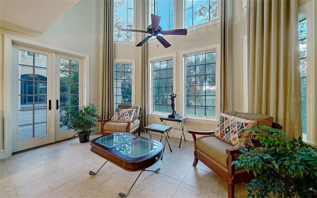 Guest house living room with soaring ceilings - Single Family Home for sale at 8257 Archers Ct, Sarasota, FL 34240 - MLS Number is N6109007