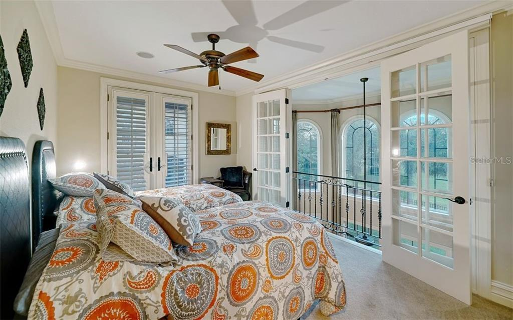 Guest house bedroom overlooking the golf course - Single Family Home for sale at 8257 Archers Ct, Sarasota, FL 34240 - MLS Number is N6109007