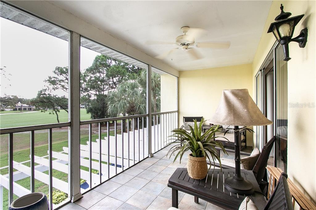 rear lanai off living room and second bedroom with golf course views and lake view with fountaing.  Nicely tiled. - Condo for sale at Address Withheld, Venice, FL 34293 - MLS Number is N6109324
