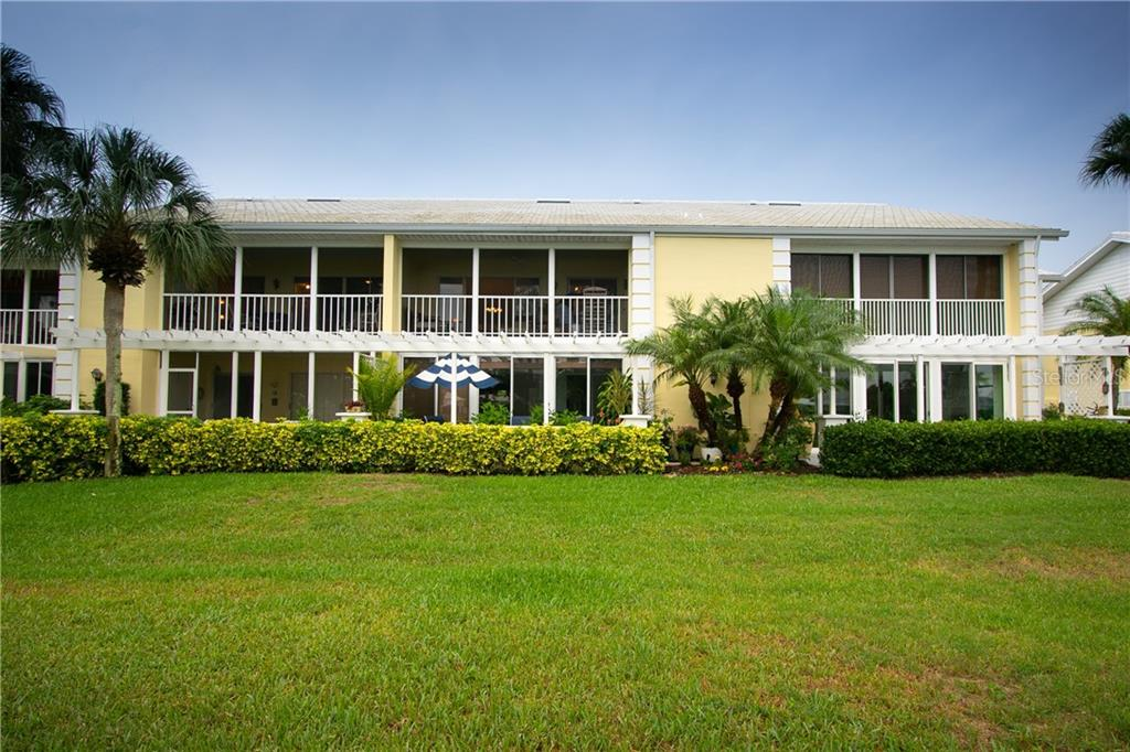 rear of building - Condo for sale at Address Withheld, Venice, FL 34293 - MLS Number is N6109324