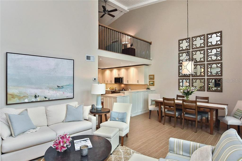 Living room/dining area, kitchen and loft - Condo for sale at 448 Palmetto Ct #B5, Venice, FL 34285 - MLS Number is N6109553