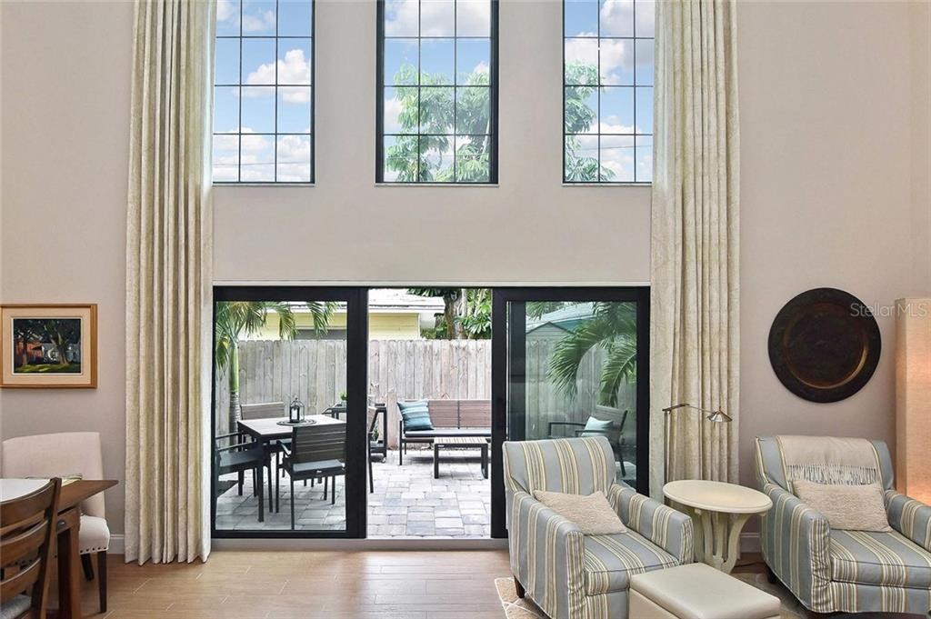 Sliders to patio - Condo for sale at 448 Palmetto Ct #B5, Venice, FL 34285 - MLS Number is N6109553