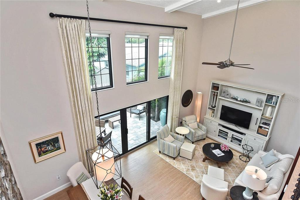 View of living room from the loft - Condo for sale at 448 Palmetto Ct #B5, Venice, FL 34285 - MLS Number is N6109553