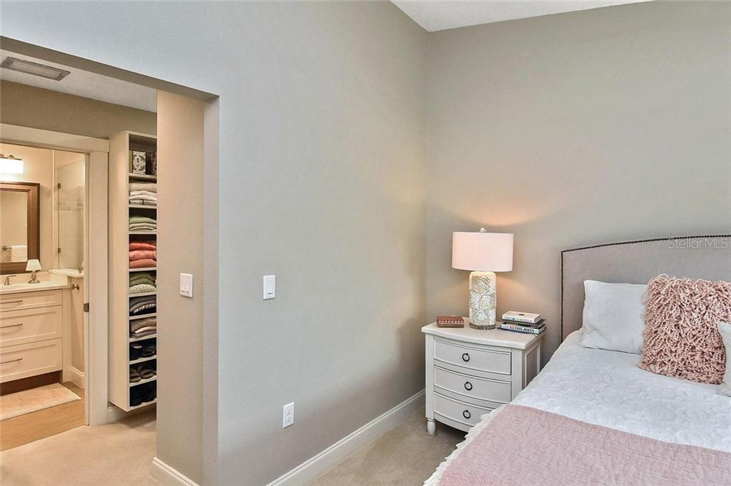 Master bedroom to walk-in closet and master bath - Condo for sale at 448 Palmetto Ct #B5, Venice, FL 34285 - MLS Number is N6109553