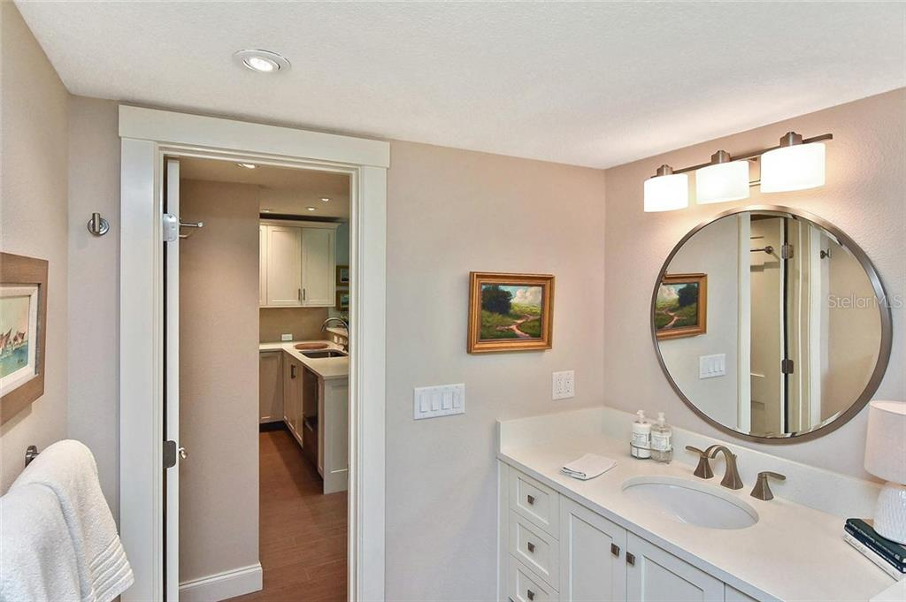 Guest bath to kitchen - Condo for sale at 448 Palmetto Ct #B5, Venice, FL 34285 - MLS Number is N6109553