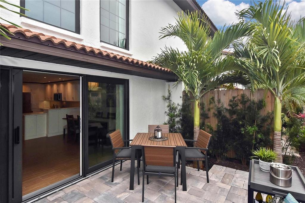 Patio to living room - Condo for sale at 448 Palmetto Ct #B5, Venice, FL 34285 - MLS Number is N6109553