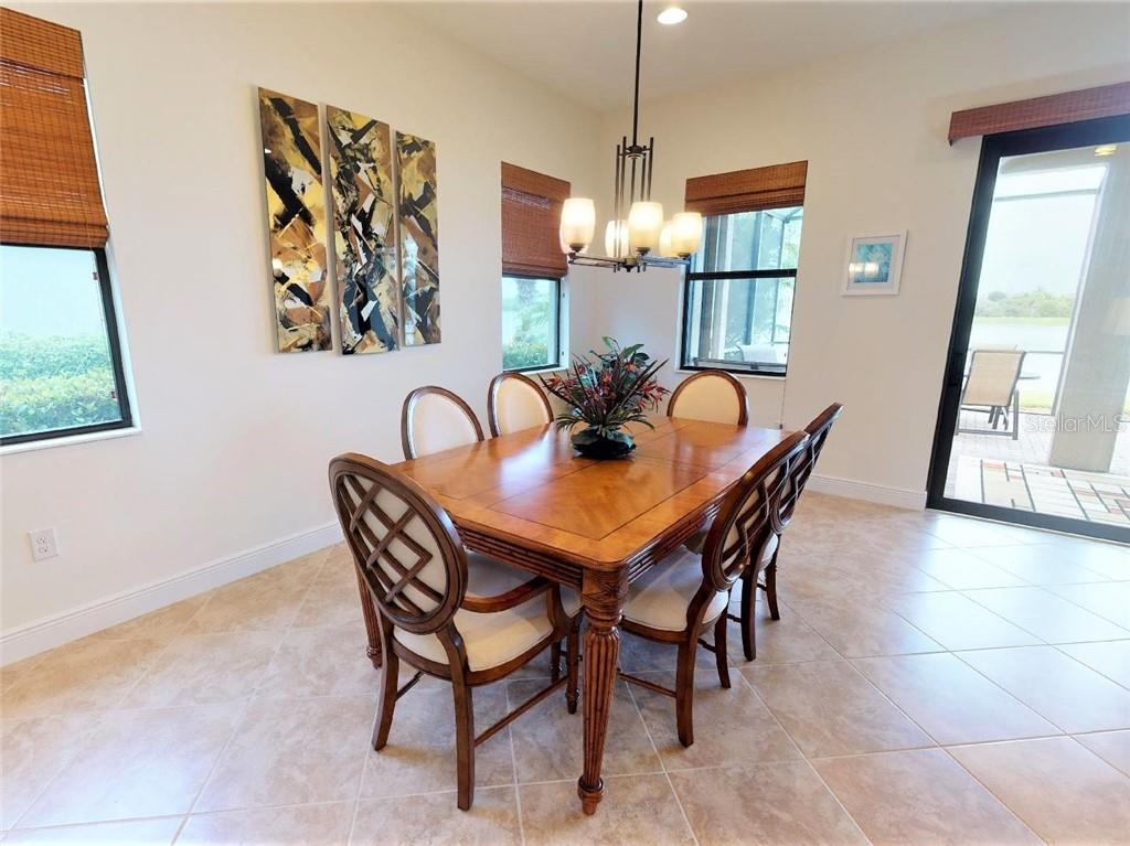 dining area open to family / great room - Single Family Home for sale at 23793 Waverly Cir, Venice, FL 34293 - MLS Number is N6112352