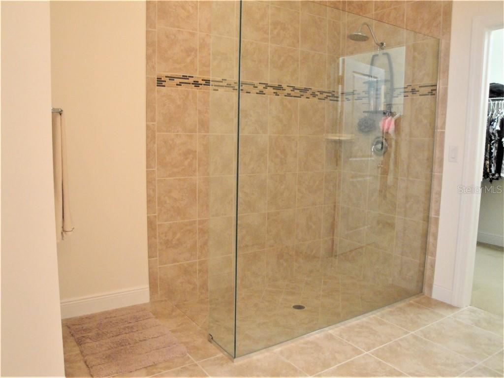 large tiled master shower with frameless glass - Single Family Home for sale at 23793 Waverly Cir, Venice, FL 34293 - MLS Number is N6112352