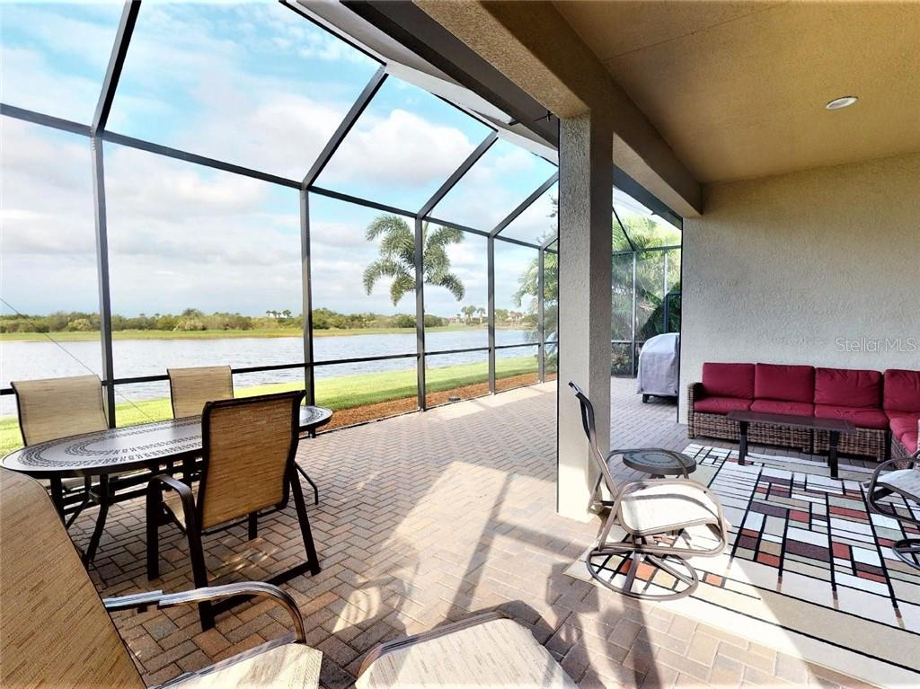 extended lanai with beautiful water & preserve views - Single Family Home for sale at 23793 Waverly Cir, Venice, FL 34293 - MLS Number is N6112352
