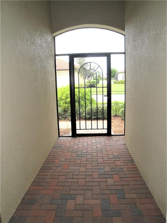 screened-in front entryway - Single Family Home for sale at 23793 Waverly Cir, Venice, FL 34293 - MLS Number is N6112352