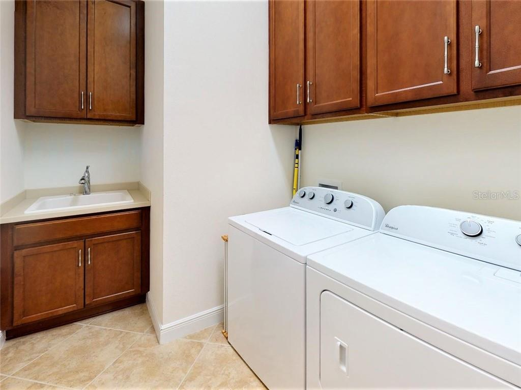 Laundry room & utility sink - Single Family Home for sale at 23793 Waverly Cir, Venice, FL 34293 - MLS Number is N6112352