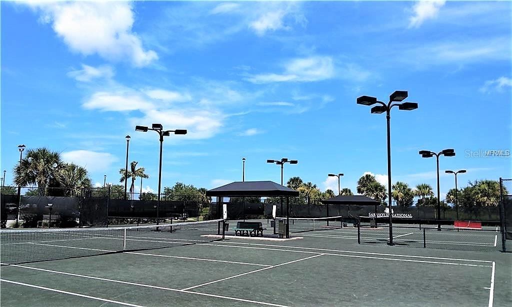 Lighted clay tennis & pickelball courts - Single Family Home for sale at 23793 Waverly Cir, Venice, FL 34293 - MLS Number is N6112352