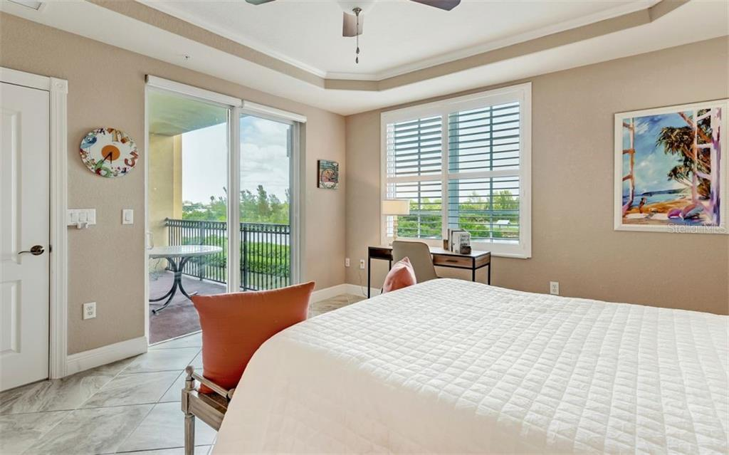 Master suite with sliders to balcony - Condo for sale at 167 Tampa Ave E #313, Venice, FL 34285 - MLS Number is N6112536