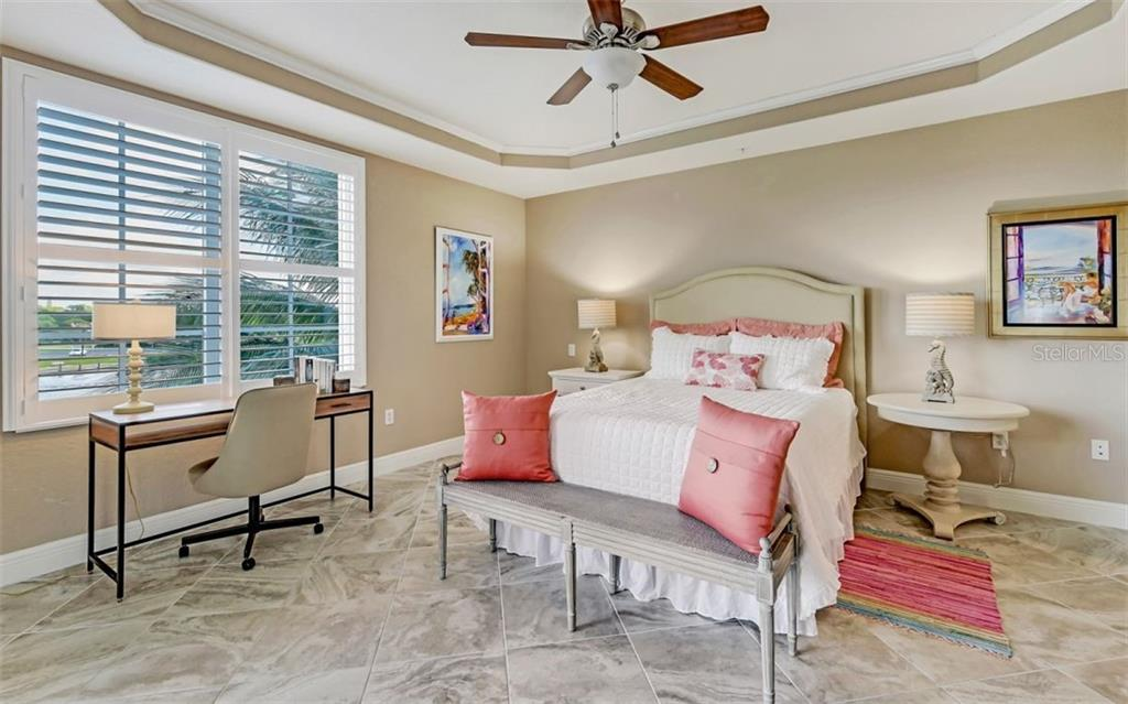 Master bedroom with water view and tray ceiling - Condo for sale at 167 Tampa Ave E #313, Venice, FL 34285 - MLS Number is N6112536