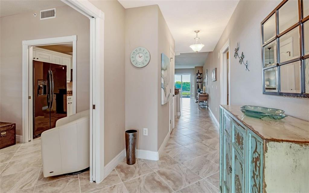 Foyer with immediate view of the water - Condo for sale at 167 Tampa Ave E #313, Venice, FL 34285 - MLS Number is N6112536