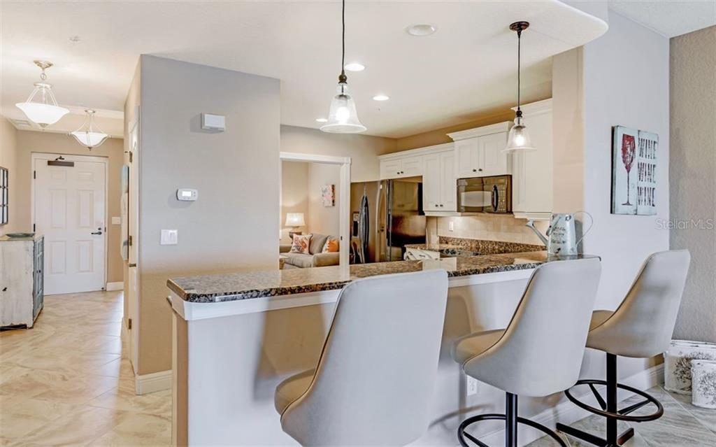 Kitchen with breakfast bar - Condo for sale at 167 Tampa Ave E #313, Venice, FL 34285 - MLS Number is N6112536