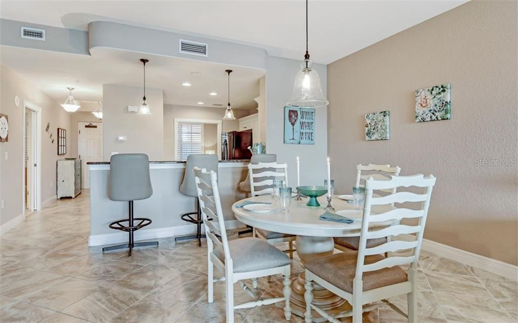 Dining room and kitchen - Condo for sale at 167 Tampa Ave E #313, Venice, FL 34285 - MLS Number is N6112536