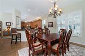 Dining room and kitchen - Single Family Home for sale at 11017 Barnsley Dr, Venice, FL 34293 - MLS Number is N6108867