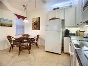 Eating space in kitchen - Condo for sale at 115 Woodbridge Dr #104, Venice, FL 34293 - MLS Number is N6108875