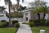 Bath house and community pool - Condo for sale at 115 Woodbridge Dr #104, Venice, FL 34293 - MLS Number is N6108875