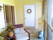 access to lanai from 2nd master suite and door to laundry room - Condo for sale at Address Withheld, Venice, FL 34293 - MLS Number is N6109324