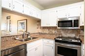 Kitchen updated with Granite and Stainless Stell - Condo for sale at Address Withheld, Venice, FL 34293 - MLS Number is N6109324