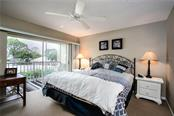 Master bedroom with private lanai - Condo for sale at Address Withheld, Venice, FL 34293 - MLS Number is N6109324